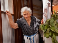Old Woman At Her Door, Paros, Greece