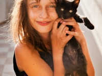 Young Girl With Her Kitten, Thira, Greece.