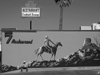 Cowboy Wating Against The Billboard