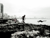 Children Jumping Over Rocks. Havana, Cuba.