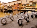 Toy Cycles At The Arno Bridge, Florence, Italy