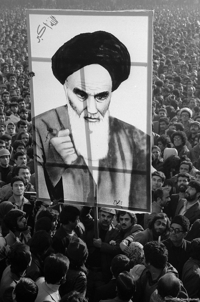 Image from the February 1979 Iranian Revolution. A poster of Khomeini at an anti-Shah rally, Tehran. David Burnett