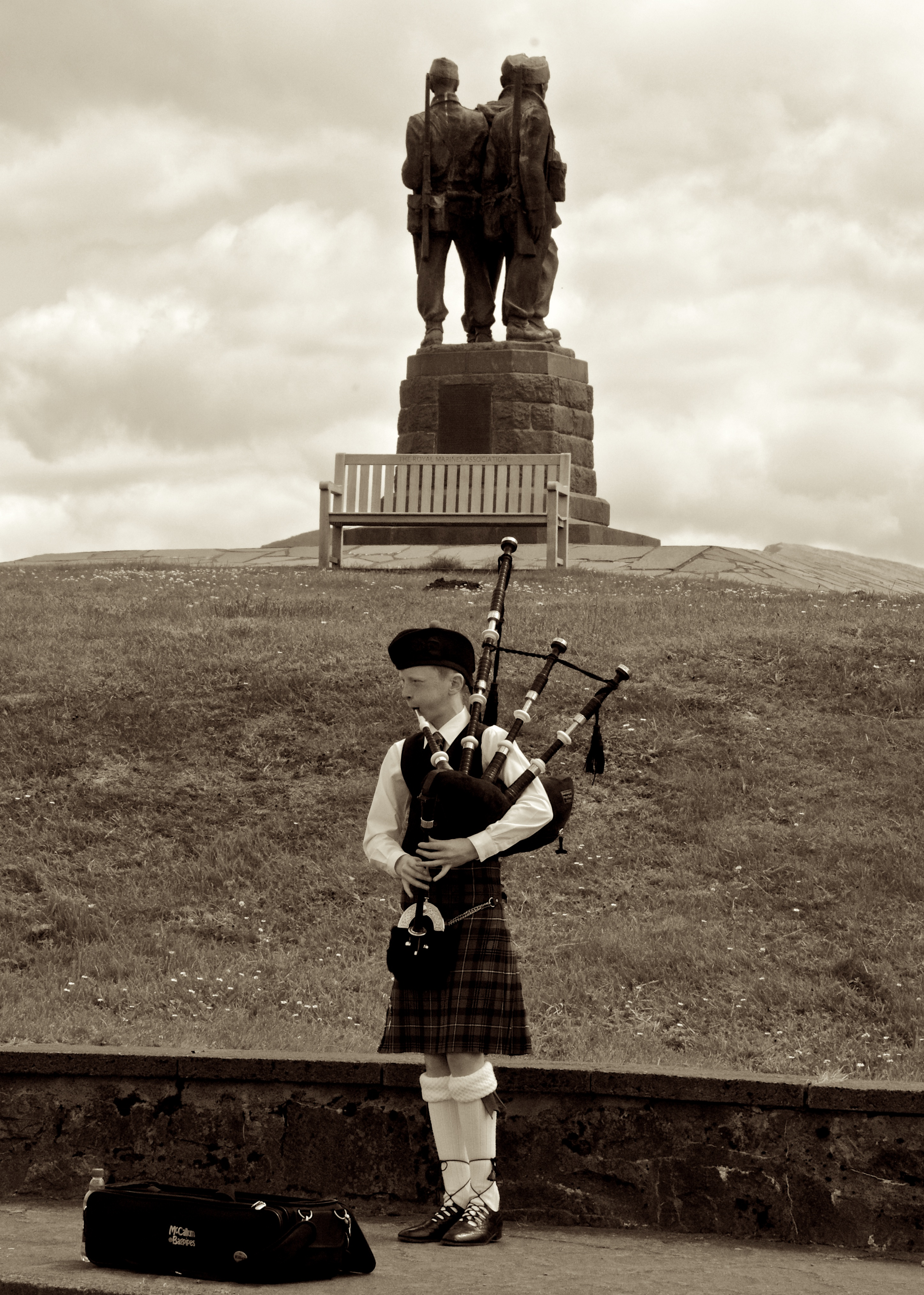 Young piper at the British Commando monument