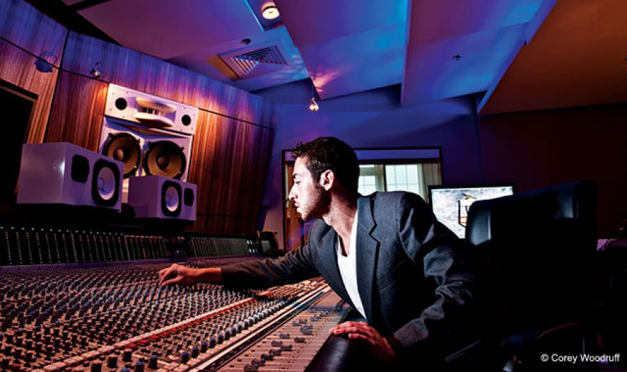 Using colored gels and directional effects, you can create a high-tech look with small flashes. In this recording studio shot, the use of blue gels transforms the background while the spotlight on the wall speakers adds dimension.