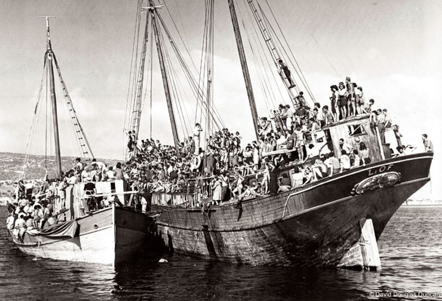 In July 1946, Duncan documented ships with thousands of Jewish refugees and Holocaust survivors attempting to enter Palestine at the Port of Haifa.