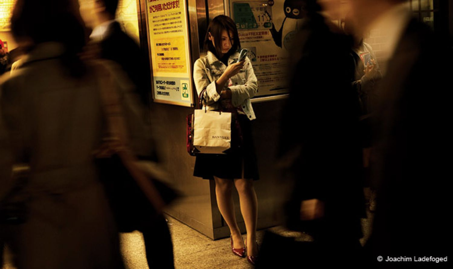 Joachim Ladefoged joined VII Photo Agency in 2004. He's a prolific photojournalist, and he pursues myriad personal projects in concert with his news photography. Above: Train station, Harajuku, Tokyo. Tokyo is an archetype of the modern metropolis. Amid the restlessness, as though protected by the never-ending din of humanity within the city, people take a break by managing to huddle in deserted stairways and corners.
