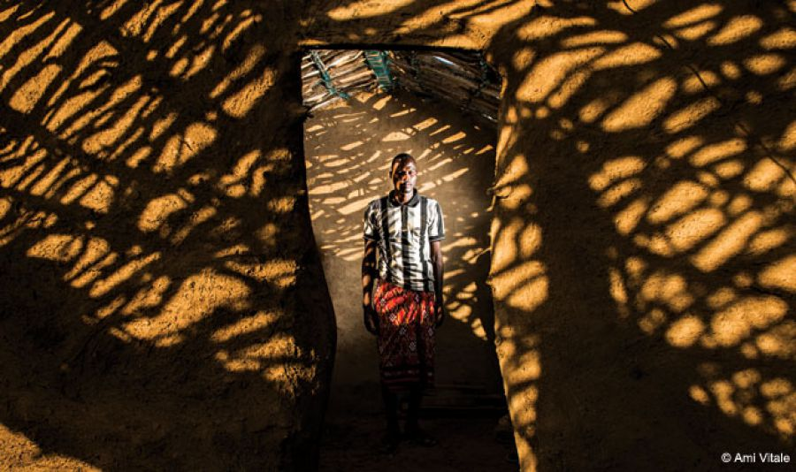 A shadowy environmental portrait of Julius Lokinyi, a former poacher who now works to protect elephants in Kenya.