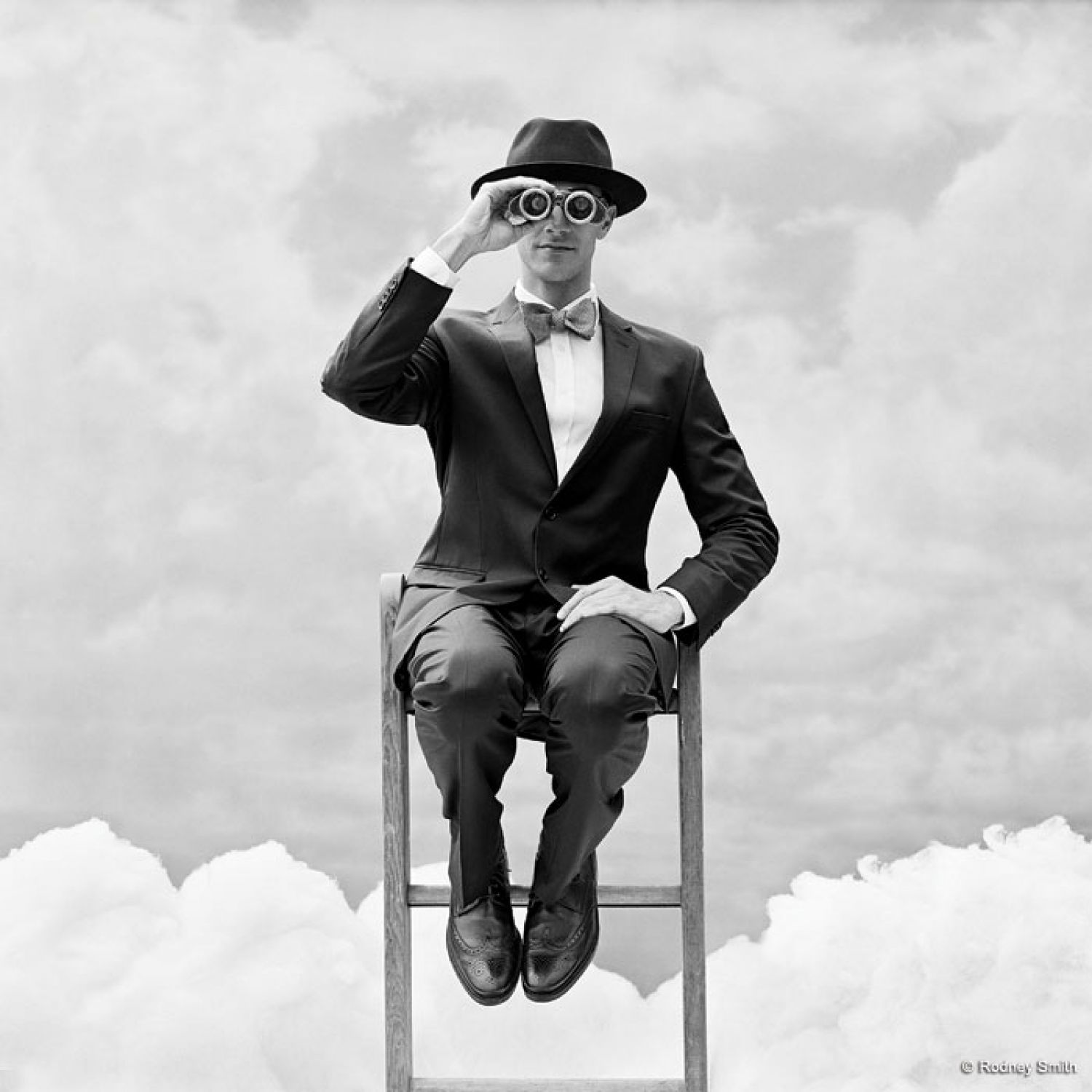 "As photography continues to evolve in the digital age, Rodney Smith shoots primarily with black-and-white film. He isn't a luddite nor does he reject technology. While some may feel limited by film, Smith enjoys the obstacles, finding that they push his creativity. A self-proclaimed classicalist, Smith's style is sophisticated, surreal and distinctly his own. His timeless photographs are relevant to modern culture without following trends. He shoots everything in-camera, such as the photograph on the opening spread, right, which became a Time Magazine cover. Smith built a physical backdrop with clouds made of cotton. ""There's not one bit of retouching. That's the fun of it for me. I'm a photographer, not an illustrator,"" he says."