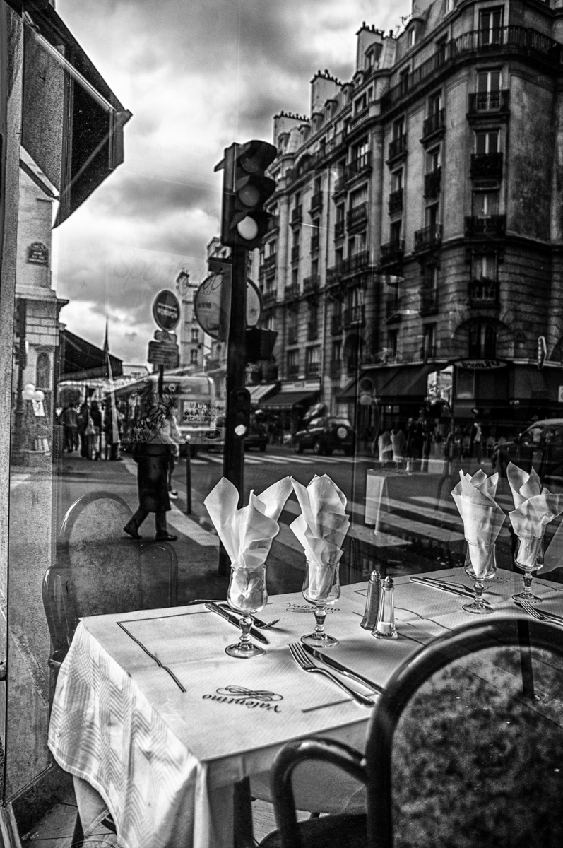 """Reflection in Paris Restaurant Window."""